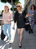 Lindsay Lohan shows her legs in short skirt walking in Beverly Hills