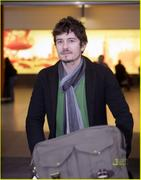 Orlando Bloom -lands in London at Heathrow Airport on Wednesday (April 14)