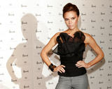 Victoria Beckham in very tight jeans and black top launches the first global concession of her dVb label at Harrods in London